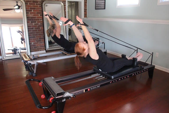 Pilates Students on Reformer