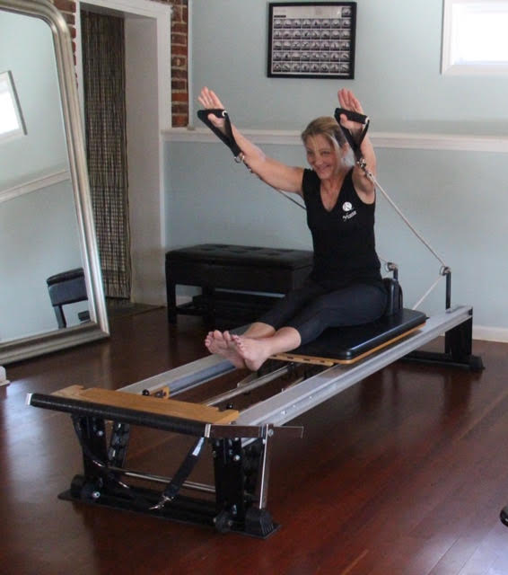 Pilates Student on Reformer in Superman Pose